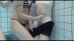 Teens give handjob and blowjob in the pool